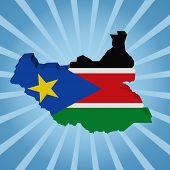 South Sudan map flag on blue sunburst illustration