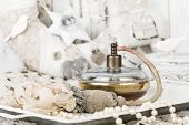 Romantic Background With Roses, Pearls Necklace, Old Bottle Of Perfume With Atomizer