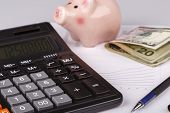 Business Charts With Calculator, Money, Piggy Box And Pen