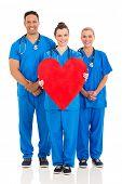 group of healthcare workers with heart symbol isolated on white background