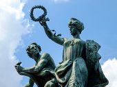 pic of turin  - Antique bronze statue in Turin representing a man and a woman with ancient clothes - JPG