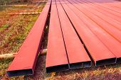 Steelworks Sprayed In Red With Spray Gun On The Ground