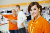 stock photo of supermarket  - Positive seller or shop assistant portrait  in supermarket store - JPG