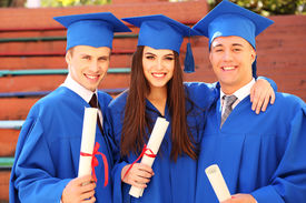 picture of graduation gown  - Graduate students wearing graduation hat and gown - JPG