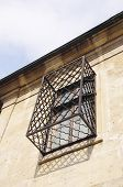 image of wrought iron  - Old wooden window with wrought Iron grill - JPG