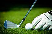 White glove, golf ball and iron
