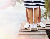 picture of pier a lake  - couple kissing on the pier near lake in hot summer day summer concept - JPG