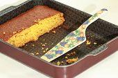 stock photo of pumpkin pie  - Piece of pumpkin cake and ceramic pie server - JPG