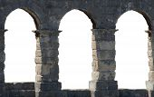 stock photo of arena  - Three windows in the ancient arena stone wall - JPG
