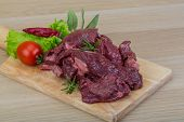 stock photo of deer meat  - Raw wild venison meat  - JPG