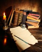 picture of inkpot  - Pile of the old books and a quill - JPG