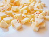 stock photo of dice  - Diced cheese with red hot chilli peppers  - JPG