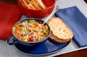 Minestrone soup in blue bowl with italian bread