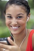 Cute Young Woman Using an MP3 Player