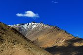 stock photo of jammu kashmir  - Rocky landscape of with blue sky and ice peaks Changla pass Leh Ladakh Jammu and Kashmir India himalaya snow changla pass travel cliff cloud high snow mountain background copy space - JPG