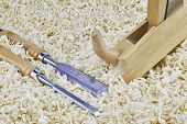 foto of chisel  - Two chisels and one spokeshave lying in wooden shavings - JPG