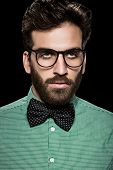 stock photo of bow tie hair  - Handsome bearded man in glasses and bow tie - JPG