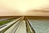 pic of toned  - Sunset over Modern Highway on the Protective Dam in Netherlands Vintage Style Toned Picture - JPG