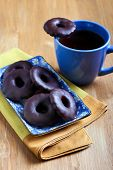 foto of biscuits  - Homemade biscuits coated with chocolate and cup of tea - JPG