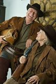 foto of gunslinger  - Two smiling hunters in western clothes - JPG