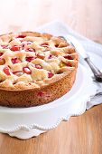 pic of sponge-cake  - Plum sponge cake on plate over wooden table - JPG