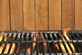 image of braai  - Flaming BBQ Charcoal Cast Iron Grill Close - JPG