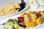 image of turkey dinner  - meat salad and hot cooked turkey meat on the table - JPG