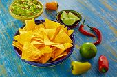 stock photo of nachos  - Mexican food nachos with guacamole chili peppers and  lemon - JPG