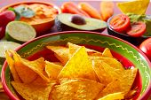 picture of nachos  - Mexican food nachos and guacamole with chili peppers and sauces - JPG