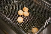 pic of scallops  - Chef is cooking appetizer with sea scallops fried in deep fat - JPG