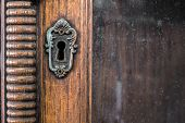 picture of keyhole  - Keyhole of old nice antique wooden cabinet - JPG