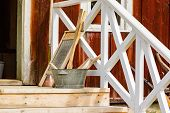 picture of washtub  - Old laundry tools on staircase outside an old farm building - JPG