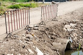 foto of safety barrier  - Old metal barriers for safety in construction site - JPG