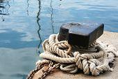 Rope Round Bollard In Marina