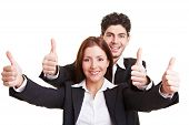 Business People Holding Thumbs Up