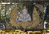 stock photo of siddhartha  - Asian decoration glass reflections from temple in Thialand - JPG