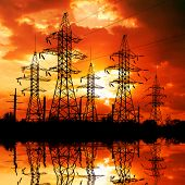 Electricity pylons on sunset background.