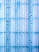 Blue corrugated surface.