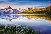 Great view of Bernese range above Bachalpsee lake. Dramatic and picturesque scene. Popular tourist a poster