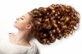 Long hair. Waves Curls updo hairstyle in salon. Fashion model, woman with healthy shiny hair. Girl w poster