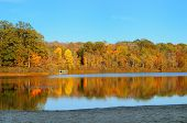 stock photo of northeast  - Autumn colors reflected in a serene lake  - JPG