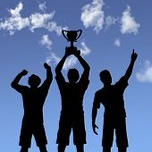 ILLUSTRATION: Silhouettes of team players win a trophy and celebrate business victory against a blue