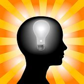 A light bulb shines in the head of a thinking woman, concept of a bright idea, invention, inspiratio