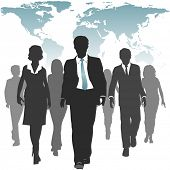 International work force of business people walks forward under a world map.
