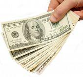 US-Dollar in der Hand, weiß, isoliert mit Beschneidungspfad