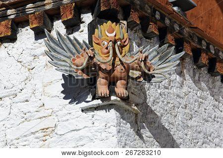 Wood carving of tibetan garuda