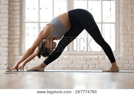 Young Sporty Attractive Woman Practicing