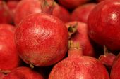 Group Of Ripe Pomegranate Fruit Close-up, Selective Focus. Red Pomegranates On The Market, Nature Ba poster
