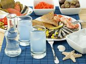stock photo of ouzo  - Seafood and ouzo - JPG