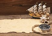 old paper and model classic boat on wood background